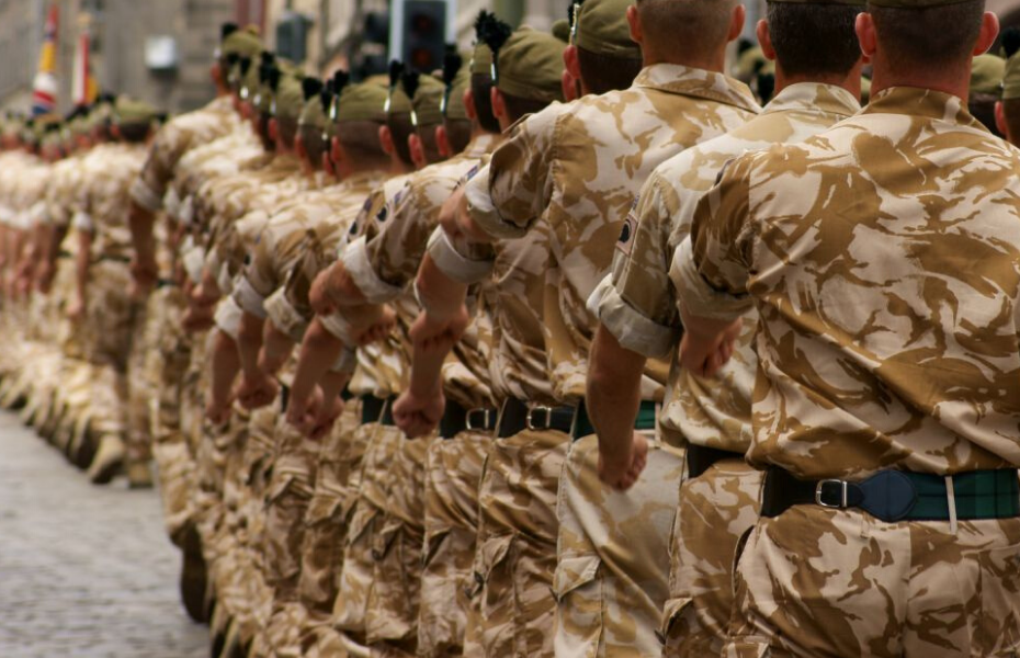 British soldiers in camouflage combat uniform marching
